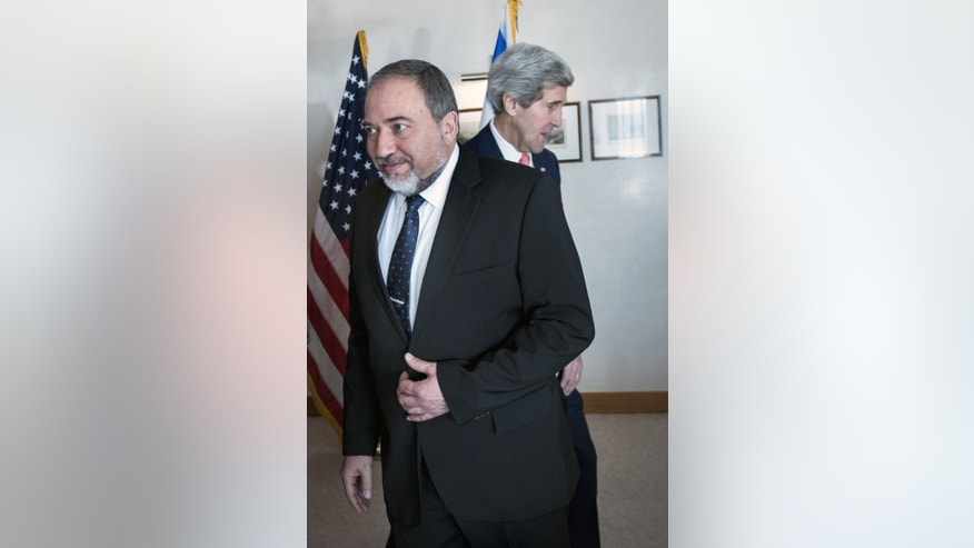 Israeli Foreign Minister Avigdor Lieberman, walks in front of U.S. Secretary of State John Kerry, ahead of their meeting at the David Citadel hotel  in Jerusalem, Friday, Jan. 3, 2013. (AP Photo/Brendan Smialowski, Pool)