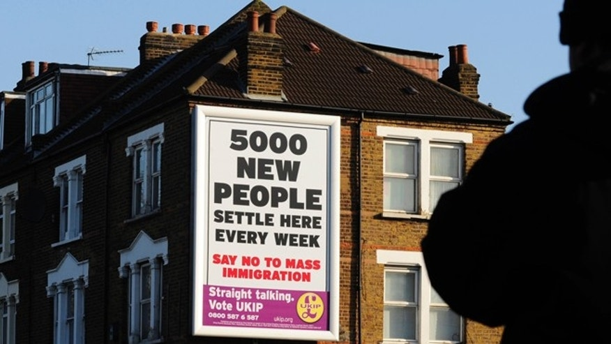 Apr. 8, 2010: A man passes a United Kingdom Independence Party election poster in west London.