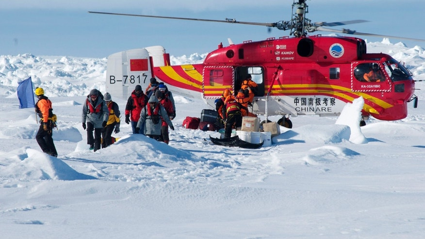 In this image provided by Australasian Antarctic Expedition, A Chinese helicopter arrives to rescue some of the 52 passengers trapped for more than a week on the icebound Russian research ship MV Akademik Shokalskiyin , Thursday, Jan. 2, 2014.  The helicopter rescued all 52 passengers from the research ship that has been trapped in Antarctic ice, 1,500 nautical miles south of Hobart, Australia, since Christmas Eve after weather conditions finally cleared enough for the operation Thursday. (AP Photo/Australasian Antarctic Expedition, Jessica Fitzpatrick) EDITORIAL USE ONLY, ONE TIME USE ONLY, NO ARCHIVES; NO SALES
