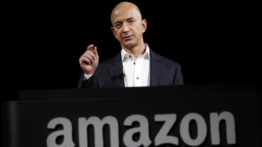 File- This Sept. 6, 2012, file photo shows Jeff Bezos, CEO and founder of Amazon, at the introduction of the new Amazon Kindle Fire HD and Kindle Paperwhite personal devices, in Santa Monica, Calif. (AP)