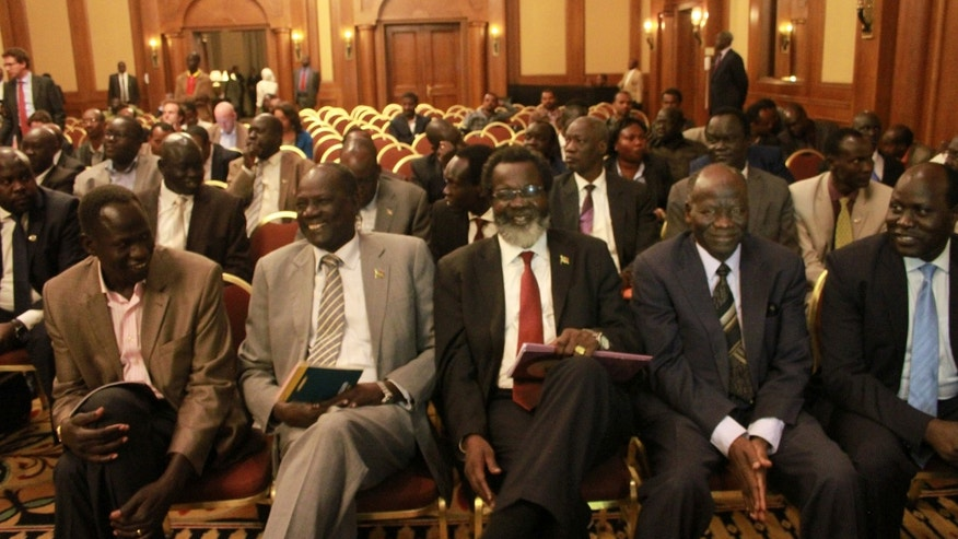 Unidentified delegates of the  South Sudan Government sit in the front row  at a press conference at the Sheraton Hotel, Addis Ababa, Ethiopia, Saturday, Jan. 4, 2014. Peace talks between warring parties in South Sudan scheduled to be held in Ethiopia were delayed Saturday because the sides haven't yet agreed upon an agenda, officials said. Late Saturday, Ethiopian Foreign Minister Tedros Adhanom said the two sides agreed to begin talks Sunday. Two areas the talks will focus on include ending hostilities and the release of political prisoners. (AP Photo/Elais Asmare)