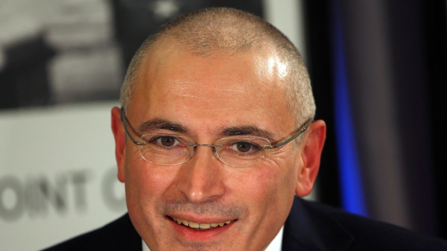 FILE - In this Dec. 22, 2013 file photo Mikhail Khodorkovsky speaks during a news conference in Berlin, Germany. Switzerland has granted Khodorkovsky a visa, the Swiss Embassy in Berlin said Monday, Dec. 30, 2013. He applied for a three-month visa shortly after his Dec. 20 arrival in Berlin, following his pardon by Russian President Vladimir Putin and release from decade-long imprisonment. (AP Photo/Michael Sohn, File)