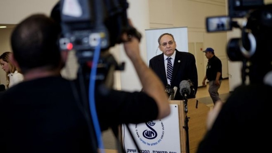 January 3, 2014: Zeev Rotstein, the director of Tel Hashomer hospital where the comatose former Israeli prime minister Ariel Sharon is being treated, informs the media about Sharon's health condition at the hospital near Tel Aviv (AP)