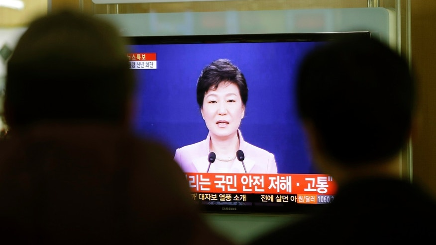 People watch a television program airing South Korean President Park Geun-hye's New Year's speech to the nation, at the Seoul Train Station in Seoul, South Korea, Monday, Jan. 6, 2014. Park called on Monday for resuming reunions of families separated by war, saying it was a chance to improve strained ties between the rival Koreas. (AP Photo/Lee Jin-man)