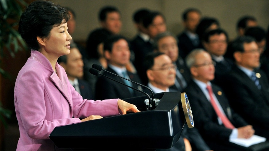 South Korean President Park Geun-hye speaks during her New Year's press conference at the presidential Blue House in Seoul, South Korea, on Monday, Jan. 6, 2014. Park called for resuming reunions of families separated by the Korean War in the early 1950s. (AP Photo/Jung Yeon-je, Pool)