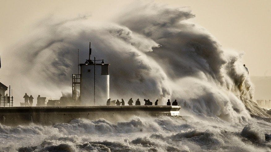 Jan. 6, 2014 - Enormous waves break on Porthcawl harbour, South Wales.  Residents along Britain's coasts braced for more flooding as strong winds, rain and high tides lash the country. At least 3 are dead in a wave of stormy weather that has battered Britain since last week.