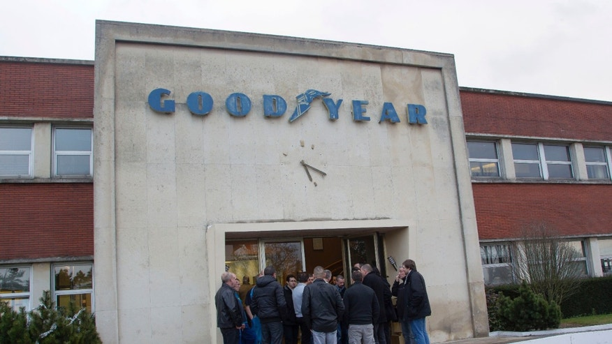 Jan. 6, 2014 - Workers of the Goodyear tire factory gather at an entrance to the plant in Amiens, northern France. 2 Goodyear managers were blocked from leaving the plant, with angry workers demanding more money in exchange for the inevitable loss of their jobs.