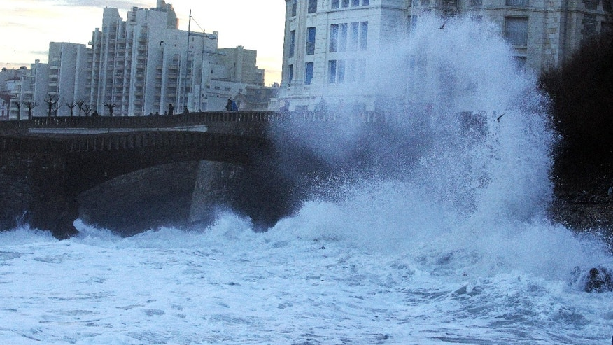 Big waves crash near the old port in Biarritz, southwestern France, Tuesday, Jan. 7, 2014. There has been a weather alert for high waves in the south west of France since Monday. (AP Photo/Bob Edme)