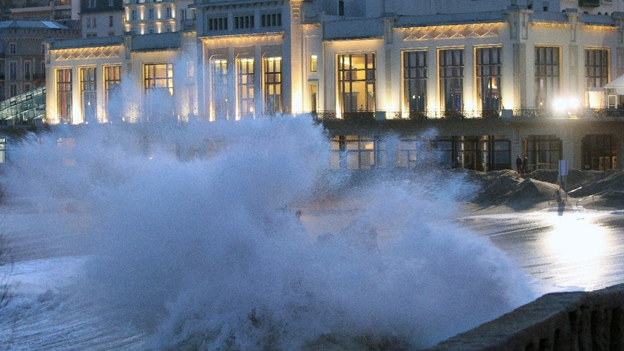 Waves crash on the beach front, outside the Biarritz casino, in southwestern France, Tuesday, Jan. 7, 2014. There has been a weather alert for high waves in the south west of France since Monday. (AP Photo/Bob Edme)