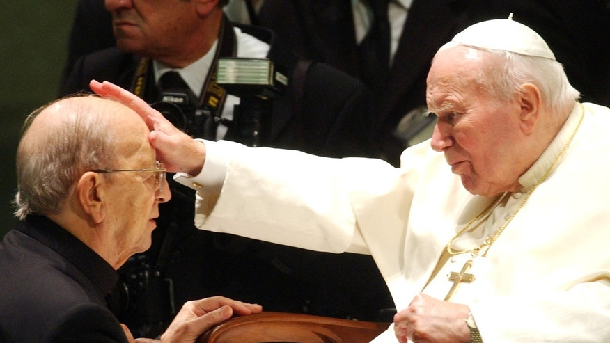 "FILE  - In this Nov. 30, 2004 file photo,  Pope John Paul II gives his blessing to late father Marcial Maciel, founder of Christ's Legionaries, during a special audience the pontiff granted to about four thousand participants of the Regnum Christi movement, at the Vatican.The troubled Legion of Christ religious order this week begins electing a new leadership for the first time since its founder, held up as a model by the Vatican, was revealed to have been a pedophile and fraud. The process will formally end the Vatican's three-year rehabilitation of the order, which the Legion is touting as a success and critics have dismissed as a sham. Several former Legion priests have written Pope Francis urging him to not fall for the Legion's ""supposed reform,"" saying the process had ignored the core issues of the congregation's dysfunction: financial duplicity, lack of an authentic religious identity and continued coverup about those who facilitated the crimes of the founder. (AP Photo/Plinio Lepri, File)"