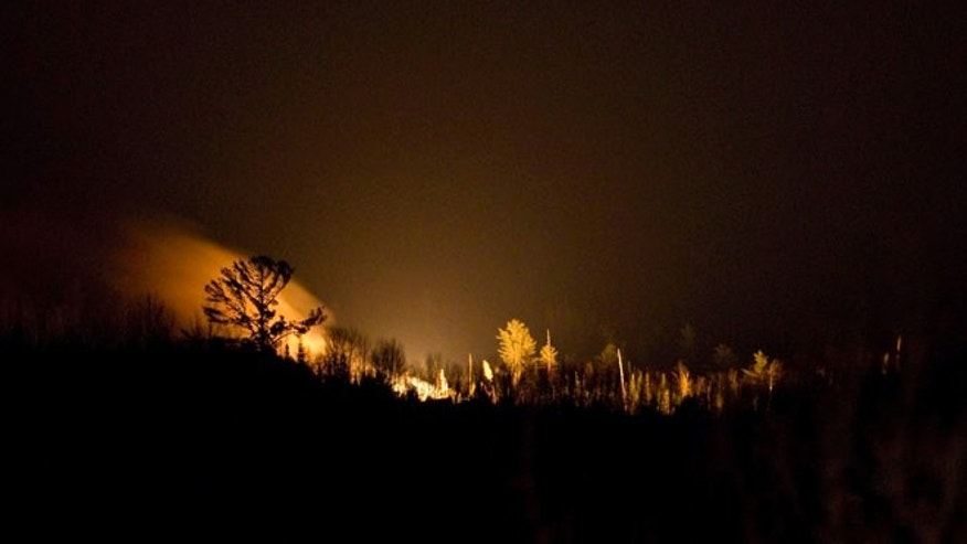 Jan. 8, 2014: Fire burns on the horizon at the scene of a train derailment near Plaster Rock, New Brunswick.