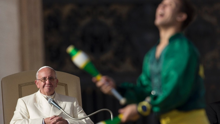 A member of Golden Circus performs in front of  Pope Francis during his weekly general audience in St. Peter's Square at the Vatican, Wednesday, Jan. 8, 2014. (AP Photo/Alessandra Tarantino)