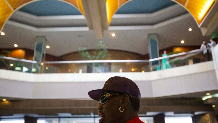 Dennis Rodman arrives at his hotel in Pyongyang, North Korea after a morning practice session on Wednesday, Jan. 8, 2014. Rodman came to the North Korean capital with a team of USA basketball stars for an exhibition game on Jan. 8, the birthday of North Korean leader Kim Jong Un. (AP Photo/David Guttenfelder)