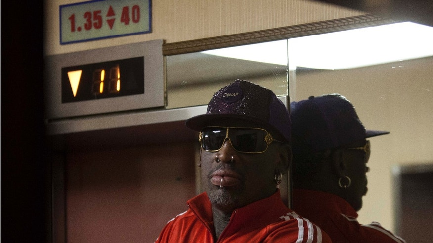 Dennis Rodman waits for the elevator as he arrives at his hotel in Pyongyang, North Korea after a morning practice session on Wednesday, Jan. 8, 2014. Rodman came to the North Korean capital with a team of USA basketball stars for an exhibition game on Jan. 8, the birthday of North Korean leader Kim Jong Un. (AP Photo/David Guttenfelder)