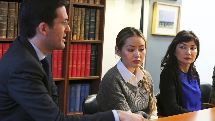 Peter Sahlas, left, the US  lawyer representing  Mukhtar Ablyazov speaks as his wife Alma Shalabayeva, right, and daughter Madina Ablyazova, centre listen,  during a press conference,  in Paris Tuesday Jan. 7, 2014. An opposition leader from a country that has been ruled by the same man since 1989, a former banker accused of siphoning off billions, Mukhtar Ablyazov has been jailed since police special forces seized him July 31 in the south of France. (AP Photo/Remy de la Mauviniere)