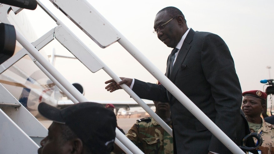 Central African Republic President Michel Djotodia boards a plane to Chad, at Mpoko Airport in Bangui, Central African Republic, Wednesday, Jan. 8, 2014. The embattled president, who has come under growing pressure to resign, traveled to neighboring Chad on Wednesday for a summit with regional leaders who want to end the bloodshed that has left more than 1,000 dead and nearly a million people displaced.(AP Photo/Rebecca Blackwell)