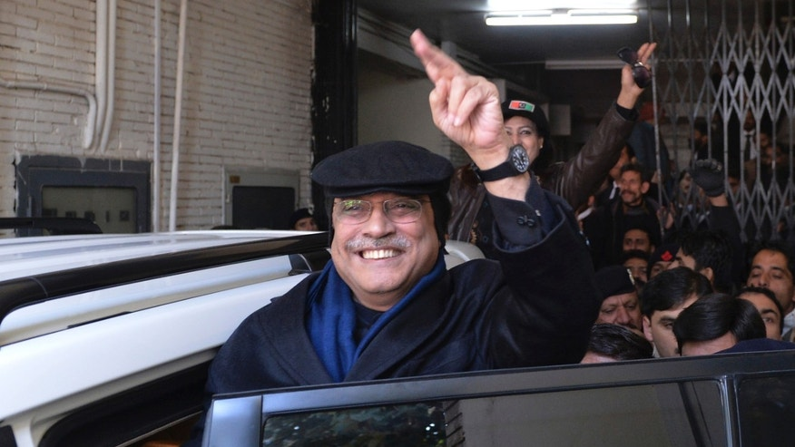 Former Pakistan's President Asif Ali Zardari, waves as he leaves a court in Islamabad, Pakistan, Thursday, Jan. 9, 2014. Zardari has appeared before accountability court to defend National Accountability Bureau's (NAB) references on corruption charges. (AP Photo/B.K. Bangash)