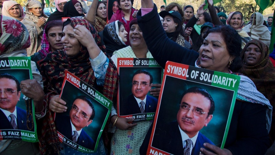 Supporters of Pakistan's People Party chant slogans in favor of their leader and former Pakistan President Asif Ali Zardari, outside a court in Islamabad, Pakistan, Thursday, Jan. 9, 2014. Zardari has appeared before accountability court to defend National Accountability Bureau's (NAB) references on corruption charges. (AP Photo/B.K. Bangash)