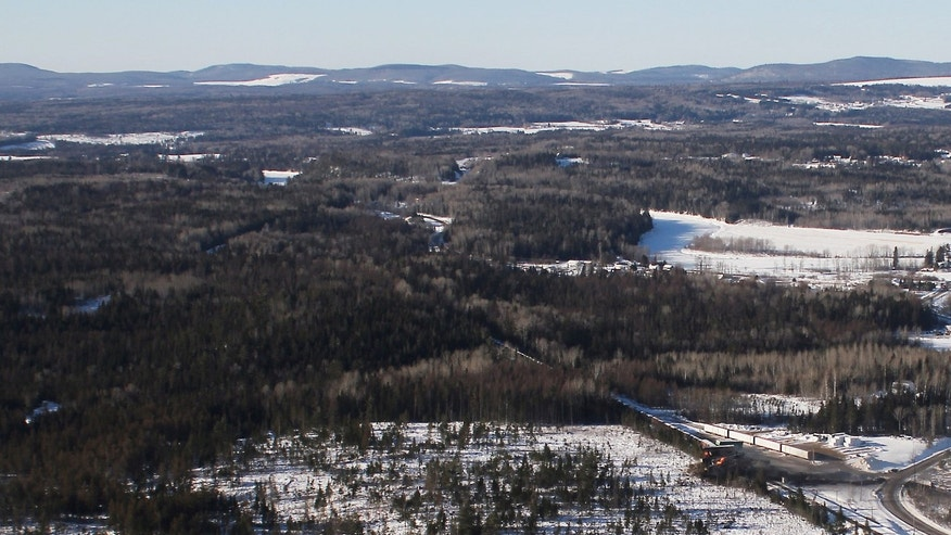 Jan. 8, 2014: This aerial photo shows derailed train cars burning in Plaster Rock, New Brunswick.