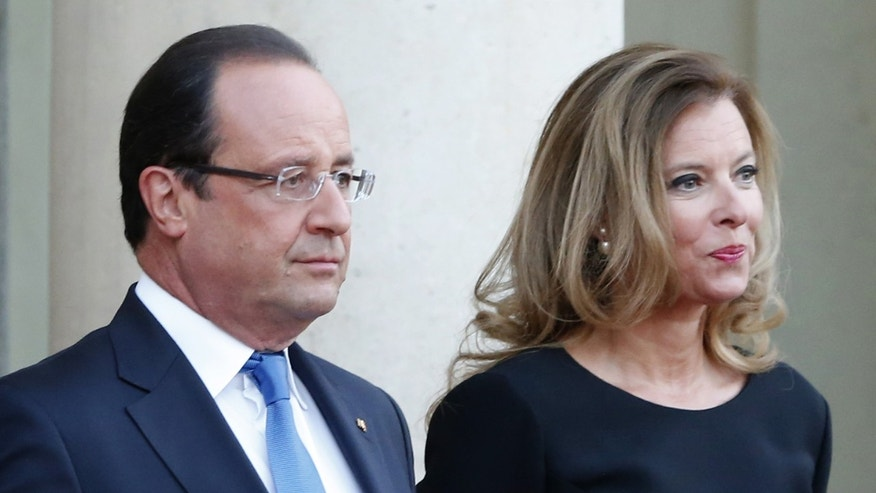 Sept. 3, 2013 - FILE photo of French president Francois Hollande and his companion Valerie Trierweiler at the  Elysee Palace, in Paris. Hollande is threatening legal action over a magazine report saying he is having a secret affair with a French actress.
