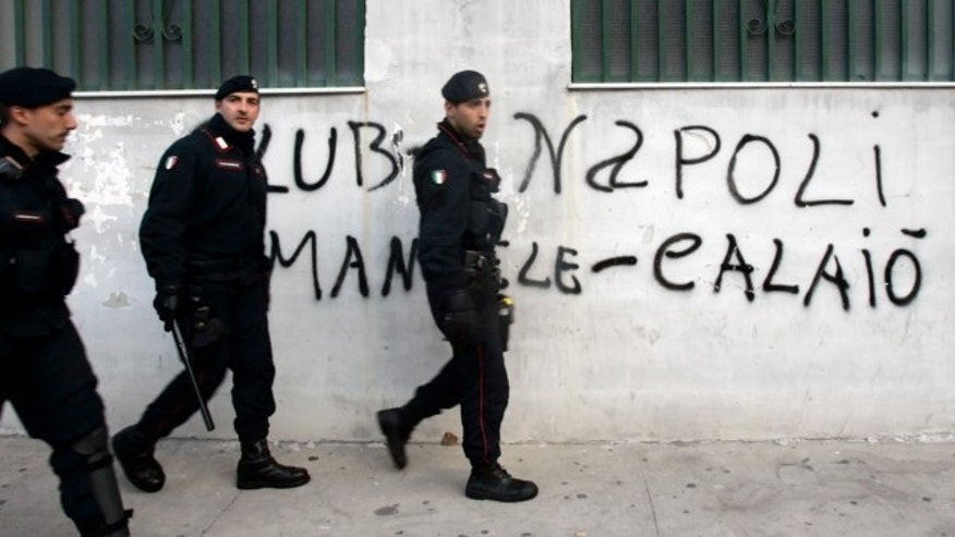 FILE: Nov. 8, 2006: Italian Carabinieri patrol the Milito district in the southern city of Naples.