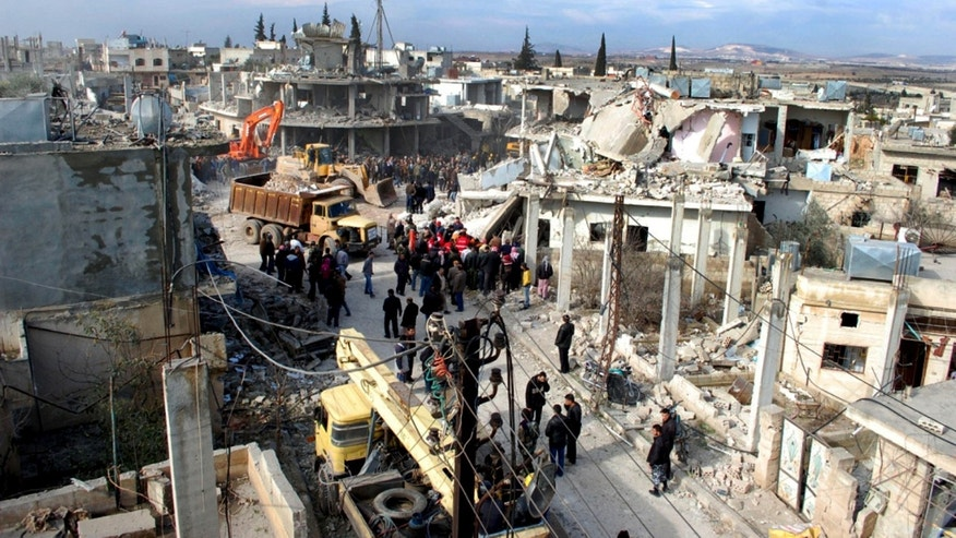 Jan . 9, 2010 - Syrian citizens gather where a car bomb exploded near a school, at al-Kaffat village in the central Hama province, Syria, killing several people and wounding dozens. (SANA)