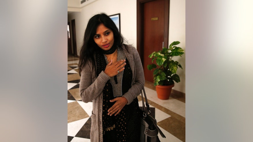 Devyani Khobragade, who served as India's deputy consul general in New York, greets journalists as she leaves Maharastra Sadan state house in New Delhi, India, Saturday, Jan. 11, 2014. Khobragade, 39, is accused of exploiting her Indian-born housekeeper and nanny, allegedly having her work more than 100 hours a week for low pay and lying about it on a visa form. Khobragade has maintained her innocence, and Indian officials have described her treatment as barbaric. (AP Photo/Saurabh Das)