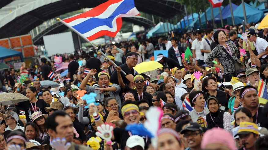 In this Nov. 11, 2013 photo, anti-government protesters gather to listen speeches at the Democracy Monument in Bangkok, Thailand. Anti-government protesters are planning to shut down Thailand's capital on Monday, Jan. 13, 2014 by blocking traffic at key intersections, providing a fitting metaphor for the country's politics: no way forward, no backing out. (AP Photo/Apichart Weerawong)