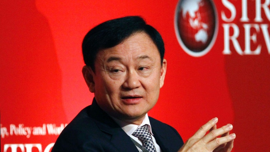 FILE - In this July 17, 2012 file photo, former Thai Prime Minister Thaksin Shinawatra pauses during a business forum and the formal launch of the Indonesian Journal of Leadership, Policy and World Affairs Strategic Review in Jakarta, Indonesia. Anti-government protesters are planning to shut down Thailand's capital on Monday, Jan. 13, 2014 by blocking traffic at key intersections, providing a fitting metaphor for the country's politics: no way forward, no backing out. That was Feb. 28, 2006, when then-Prime Minister Thaksin was seeking to defuse protests against his rule by calling early elections, and the opposition Democrat Party refused to take part. In September that year, the army deposed Thaksin in a coup. (AP Photo/Achmad Ibrahim, File)