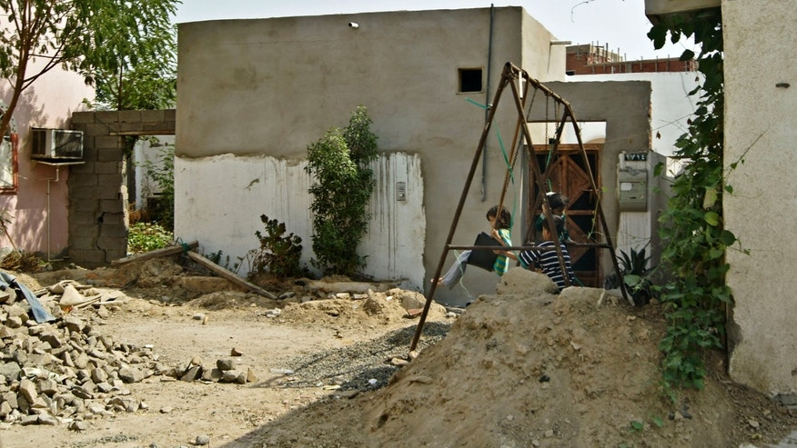 In this Feb. 8, 2010 image released by the Jeddah Development and Urban Regeneration Company shows an unplanned settlement, or slum neighborhood, of Al-Salamah in Jiddah, Saudi Arabia. (AP Photo/Usamah Shehata , Jeddah Development and Urban Regeneration Company)