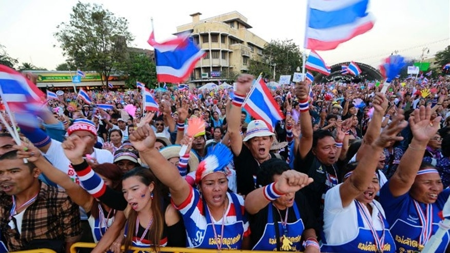 Jan. 12, 2014: Thai anti-government protesters shout and cheer during a rally at the Democracy Monument in Bangkok.