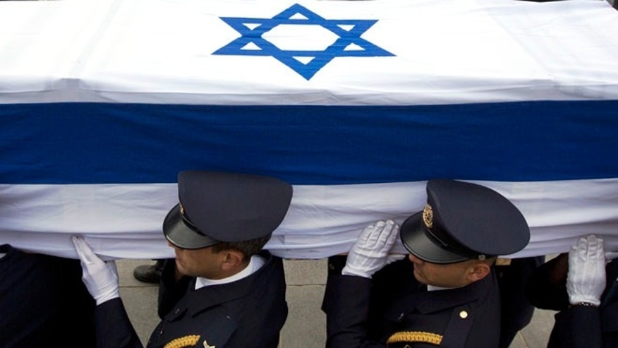 Jan. 12, 2014: Members of the Knesset guard carry the coffin of late Israeli Prime Minister Ariel Sharon at the Knesset, Israel's Parliament, in Jerusalem.