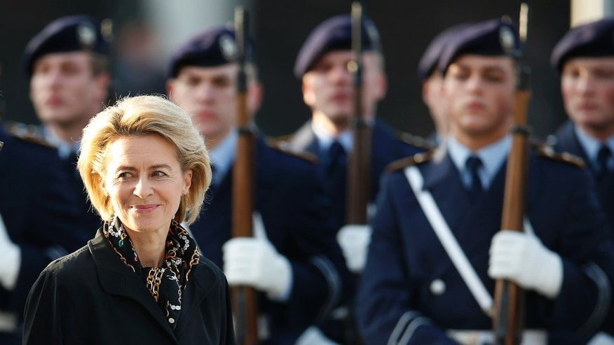 FILE - In this Dec. 17, 2013 file picture German Defense Minister Ursula von der Leyen pass soldiers during an office handing-over ceremony at the defense ministry in Berlin, Germany. Germany's new defense minister is pledging to make the country's military more attractive for people with young families as the all-professional force seeks recruits. Ursula von der Leyen, a mother of seven, became Germany's first female defense minister last month - inheriting an ongoing military overhaul after Germany abandoned conscription in 2011.  (AP Photo/Michael Sohn)