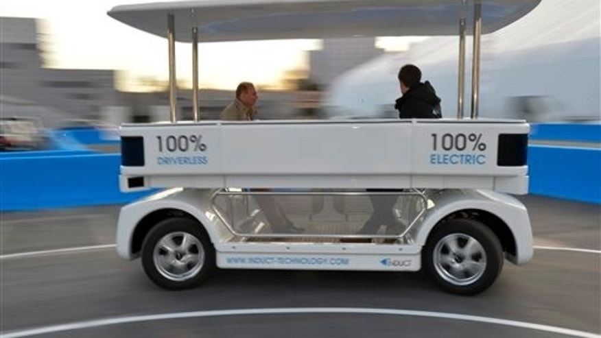 Induct demonstrates their new Navia driverless shuttle at the International Consumer Electronics Show, Monday, Jan. 6, 2014, in Las Vegas. (AP Photo/Jack Dempsey)