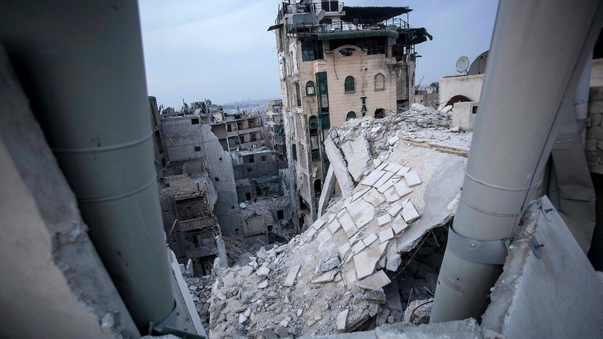 FILE - In this Thursday, Nov. 29, 2012 file photo, destroyed buildings, including the Dar Al-Shifa hospital, bottom, lay in ruins following airstrikes in Aleppo, Syria, in this file photo dated Thursday, Nov. 29, 2012.  In the summer of 2012 fighting spread to the former commercial capital, Syria's largest city Aleppo, with rebel forces controlling some neighborhoods, but the battle for overall control continues to this day and much of the city lays in ruins. (AP Photo/Narciso Contreras, File)