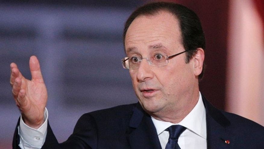 Jan 14, 2014: French President Francois Hollande answers a reporter during his annual news conference.