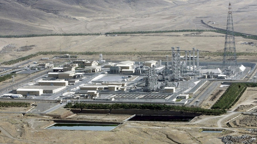 FILE- In this Saturday, Aug. 26, 2006 file photo, an aerial view of a heavy-water production plant in the central Iranian town of Arak. Iran's reformers and moderate conservatives welcomed an agreement between Iran and six world powers on how to implement a nuclear deal struck in November, saying it will shore up Iran's sanctions-hit economy but hardliners still remain opposed. The six-nation group - the five permanent members of the U.N. Security Council plus Germany - and Iran have agreed to start implementing the terms of the historic interim deal from Jan. 20. That will start a six-month clock for a final deal to be struck over the Islamic Republic's contested nuclear program. (AP Photo/ ISNA, Arash Khamoushi, File)