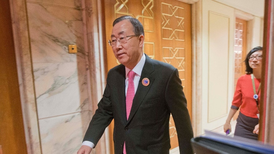 UN Secretary General Ban Ki-Moon walks out to prepare to greet U.S. Secretary of State John Kerry before the start of their meeting at Bayan Palace in Kuwait City, Kuwait, Wednesday, Jan. 15, 2014. (AP Photo/Pablo Martinez Monsivais, Pool)