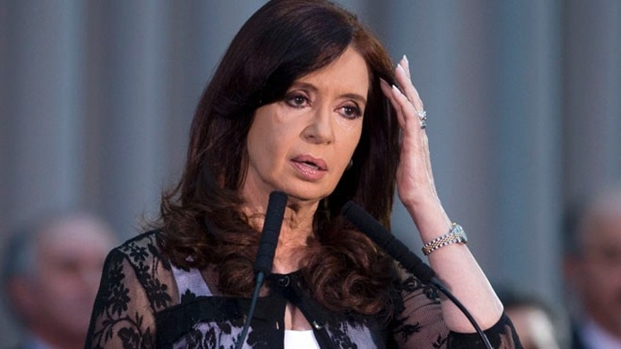 Dec. 10, 2013: In this file photo, Argentina's President Cristina Fernandez pauses as she speaks at an event marking the 30 year anniversary of the return of democracy in Buenos Aires, Argentina.