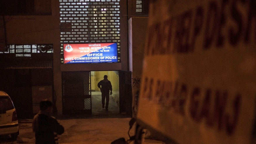 Jan. 15, 2014: An Indian policemen walks out of the police station which is investigating the gang-rape of a Danish tourist in New Delhi, India.