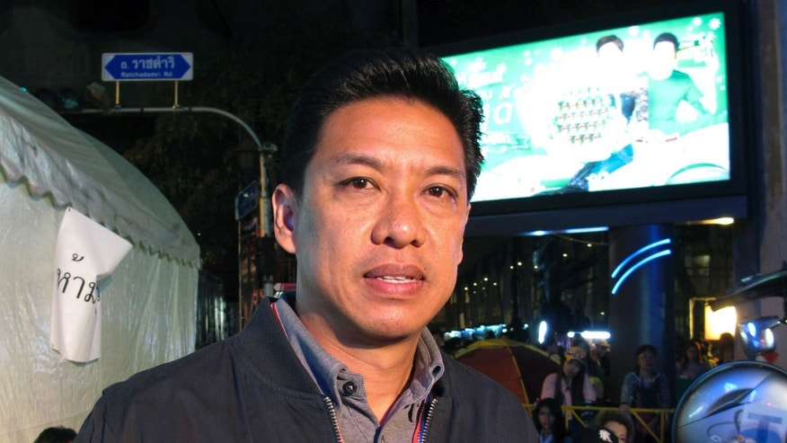 "In this photo taken Wednesday, Jan. 15, 2014, Buddhipongse Punnakanta, a leader of the People's Democratic Reform Committee, the group organizing the ""Shut Down Bangkok"" protest, poses for a photo at a rally site in Bangkok, Thailand. ""I think we've made the right decision (in shutting down Bangkok) but it will take time because we are here peacefully. This is the only way to lead the people to win,"" Punnakanta said. (AP Photo/Thanyarat Doksone)"