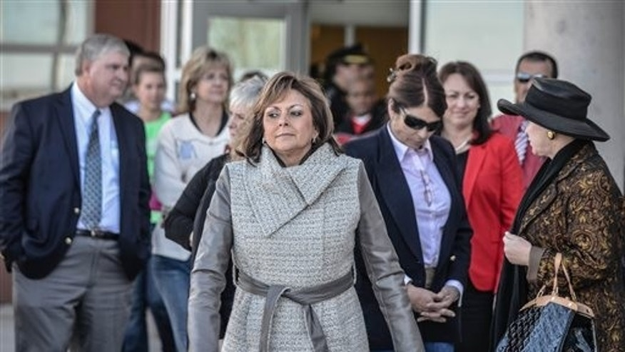 New Mexico Gov. Susana Martinez arrives for a press conference at Berrendo Middle School Tuesday, Jan. 14, 2014 in Roswell, N.M.