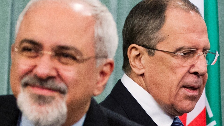 "Russian Foreign Minister Sergey Lavrov, right, and his Iranian counterpart Javad Zarif, right, attend a news conference at the Foreign Ministry in Moscow, Russia, Thursday, Jan. 16, 2014. Russia said Iran will ""inevitably"" take part in any resolution of the civil war in Syria, and that Moscow is not working on a separate track with Damascus and Tehran to resolve the conflict. (AP Photo/Pavel Golovkin)"