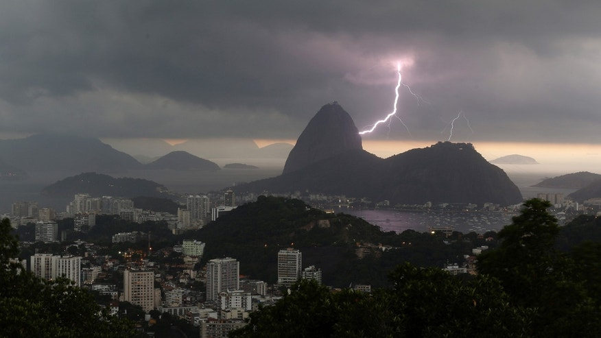 Lightning lights up the the sky over Sugar Loaf mountain in Rio de Janeiro, Brazil, Thursday, Jan.16, 2014. An alert was called by Rio authorities due to heavy rains and the possibilty of floods in the city. (AP Photo/Leo Correa)