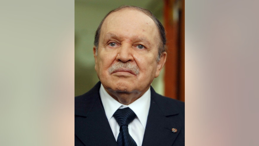 FILE - This Monday, April, 16, 2012 file photo shows Algerian President Abdelaziz Bouteflika in Algiers. Algeria's presidency says the country's ailing president has been in a Paris military hospital since Monday for a routine checkup and his condition is improving. Abdelaziz Bouteflika suffered a stroke in April and was hospitalized for four months in Paris' Val-de-Grace hospital. He has seemed visibly weak in rare television appearances since then. (AP Photo/Sidali Djarboub, File)