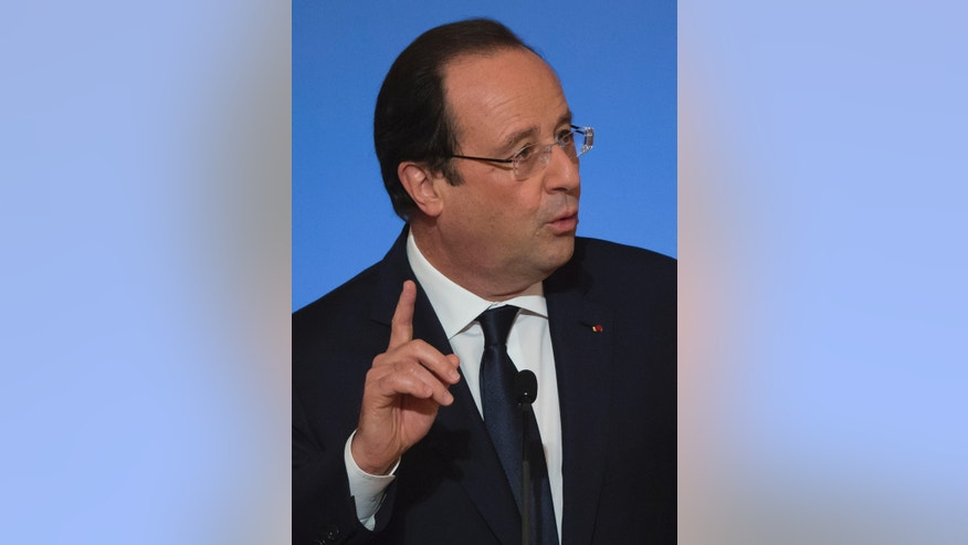 France's President Francois Hollande, gestures as he gives a New Year speech to foreign ambassadors to France, at the Elysee Palace in Paris, Friday, Jan. 17, 2014. (AP Photo/Michel Euler, Pool)