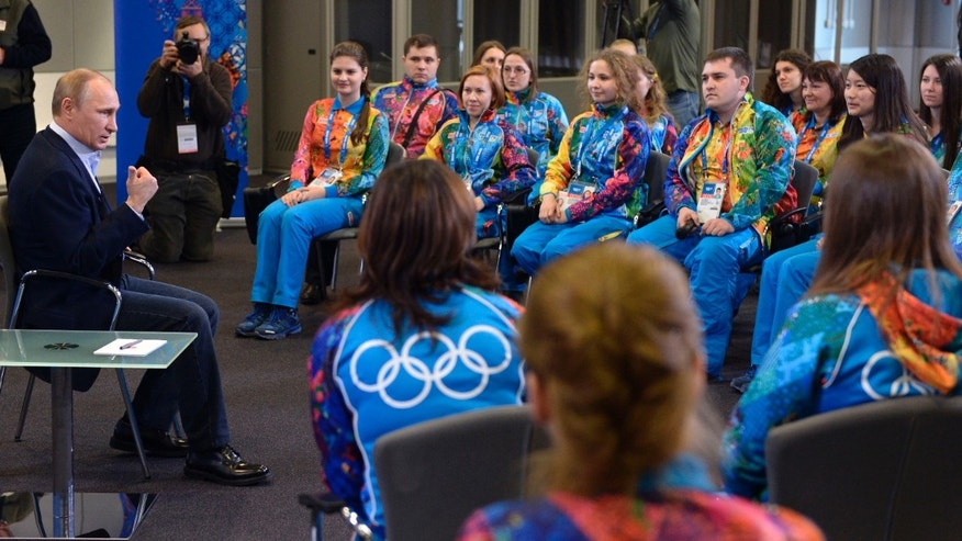 "Jan. 17, 2014 - Russian President Vladimir Putin speaks at his meeting with Olympic volunteers in the Black Sea resort of Sochi, Russia. Putin says gays should feel welcome at the upcoming Winter Olympic Games in Sochi, but they must  ""leave the children in peace."""