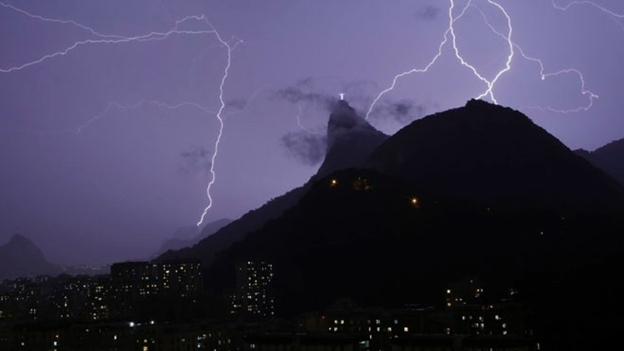 Jan. 16, 2014: Lightning bolts strike through the sky near Christ the Redeemer statue in Rio de Janeiro, Brazil.