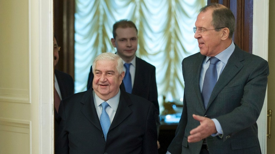 Jan. 17, 2014 - Russian Foreign Minister Sergey Lavrov, right, and his Syrian counterpart Walid al-Moallem arrive for talks in Moscow, Russia, on Syria. Foreign Minister said Friday that his country is prepared to implement a cease-fire in the war-torn city of Aleppo and exchange detainees with the country's opposition forces.