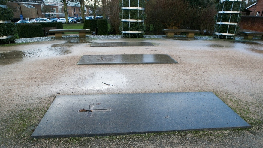 Jan. 17, 2014 - Three grave stones mark the site where Hyde Abbey once stood in Winchester, England. Researchers said Friday they may have discovered remains of King Alfred the Great, the 9th-century royal remembered for protecting England from the Vikings and educating a largely illiterate nation.